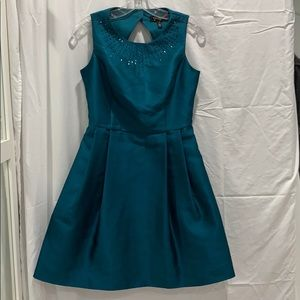 A dark green colored dress. Size 2-4